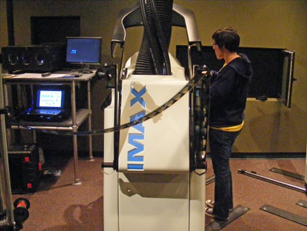 Becky Donovan, assistant projectionist, loads 15/70 IMAX film into $600,000 projector,  IMAX at Patriot Park, National Infantry Museum,  Columbus, Georgia