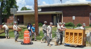 Ft. Benning soldiers, volunteers from the 39th AG,  move piano from old Mildred Terry Library to new Mildred Terry Library, Columbus, Georgia