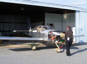 Linn Hall rolling his RV-6A out of his hangar, Columbus Metropolitan Airport, Columbus, GA
