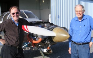 Linn Hall and me in posing in front of his RV-6A.  Fellow retired brodcaster Don Nahley took this picture.