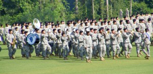 Infantry Center Band leading basic training graduates on to Parade Field