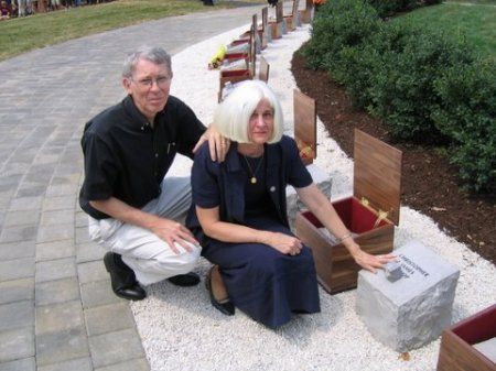 Michael and Jeri Bishop at their son Jamie's memorial stone, Virginia Tech, Virginia