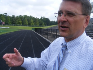 Dr. Gibson explained that the new $2.5 million track at Kinnett will be nine lanes, all wider than the lanes on the present track