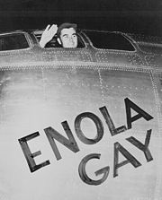 Col. Paul Tibbets waving from the Enola Gay, 1945 (Photo by the U.S. Army Air Force)