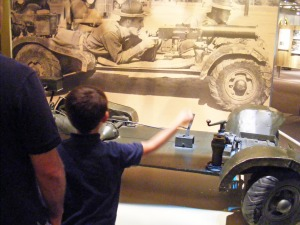"Dad and son viewing 1930's machine gun carrier called a ""Belly-flopper,"" National Infantry Museum, Columbus, GA"