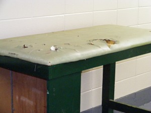 Torn training table in Kinnett Stadium locker room