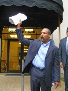 OAF SW GA Field Director Ken King waves petitions in front of Rep. Sanford Bishop's Columbus office