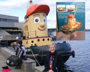 Theodore the Tugboat docked near the Museum of the Atlantic, and (inset) the actual model that was used in making the annimated TV show, which is displayed in the museum, Halifax, Nova Scotia