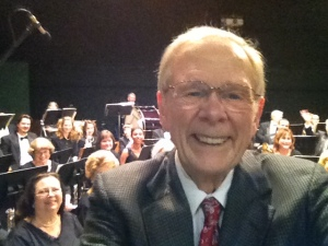 Selfie of mc in front  of Bob Barr  Community  Band